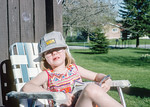 Helen rocking a Via hat while chilling with patio literature.