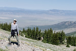 Mali on the Mount Wheeler summit trail. The valley to the west of Mount Wheeler has a windfarm in it. The turbines are large but from here they look like little white sticks. Why are wind tu ...